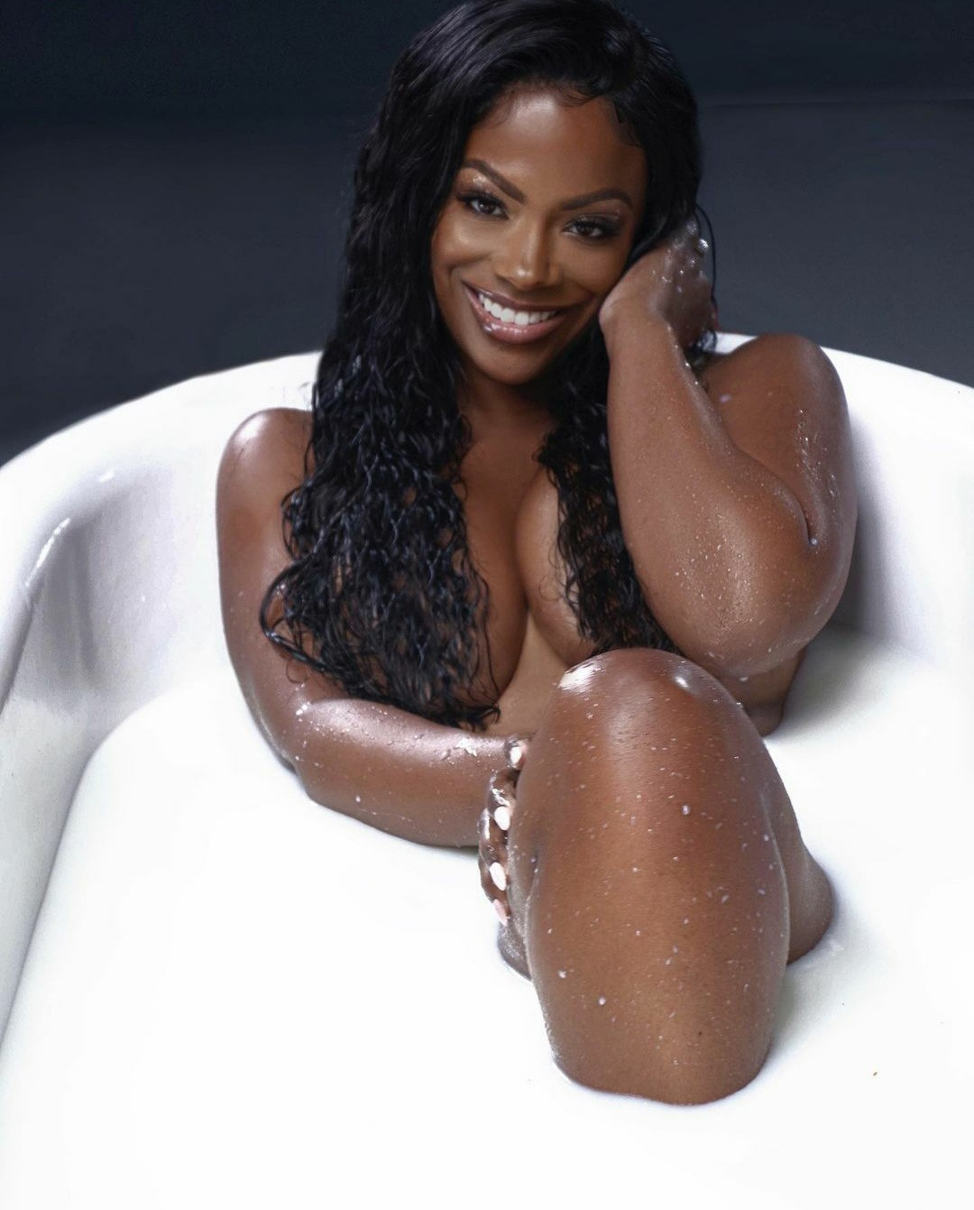 Kandi Burruss strips to her birthday suit as she poses in tub