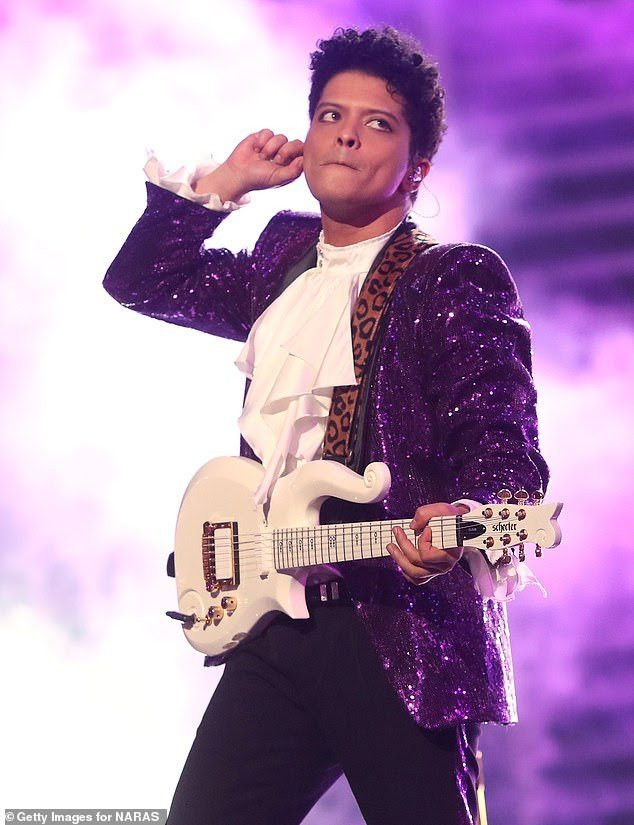 2 Nigerians arrested for posing as singer Bruno Mars to scam 68-year-old American woman of $100K in the U.S