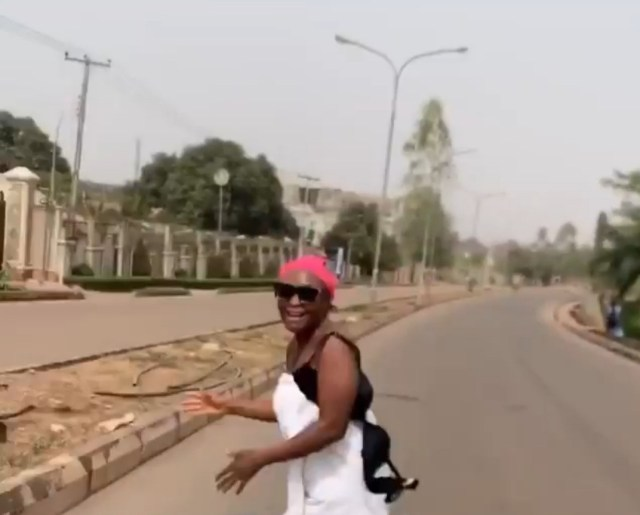 Blessing Okoro goes into the street in just her towel with panties on her head to celebrate 500K followers on Instagram (video)