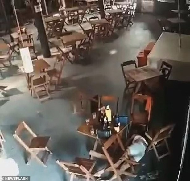 Terrifying moment jealous wife shoots dead younger woman sitting next to her husband in a bar (video)