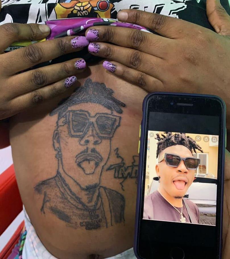 Lady tattoos singer Mayokun