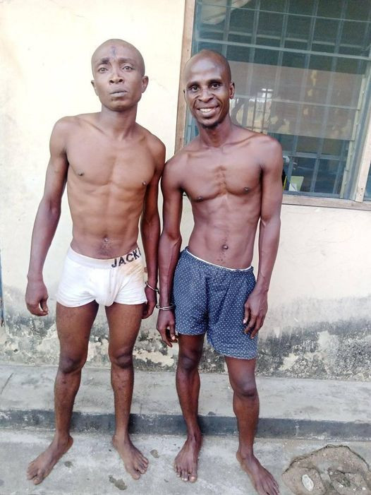 Suspected thief smiles for the camera after he was arrested by UNICAL security operatives
