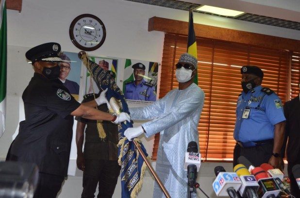 Adamu Mohammed hands over to acting IGP Usman Alkali Baba (photos)