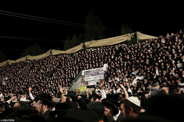 Video shows huge crowd of 100,000 dancing just before stampede that killed at least 44 Orthodox Jews at religious bonfire festival in Israel