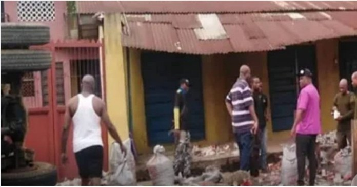 Truck falls and spills bullets onto the streets of Onitsha