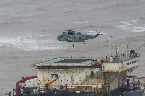 Search continues for more than 78 missing at sea after fierce cyclone sinks barge in India killing 33