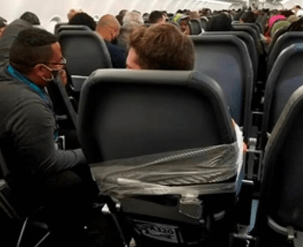Passenger taped to plane seat after groping two flight attendants