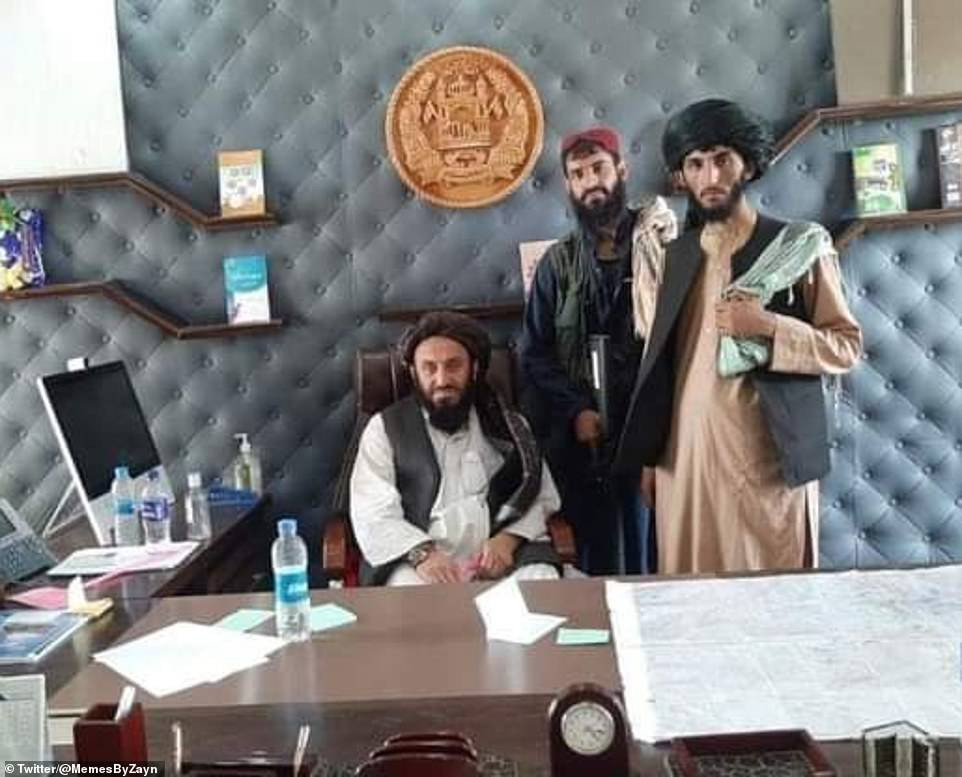Smiling Taliban militants declare 'Islamic Emirate of Afghanistan' as they pose for photos in presidential palace