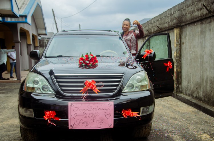 """""""Private jet is next"""" - Nigerian pastor declares as he surprises wife with Lexus car on wedding anniversary for being a"""