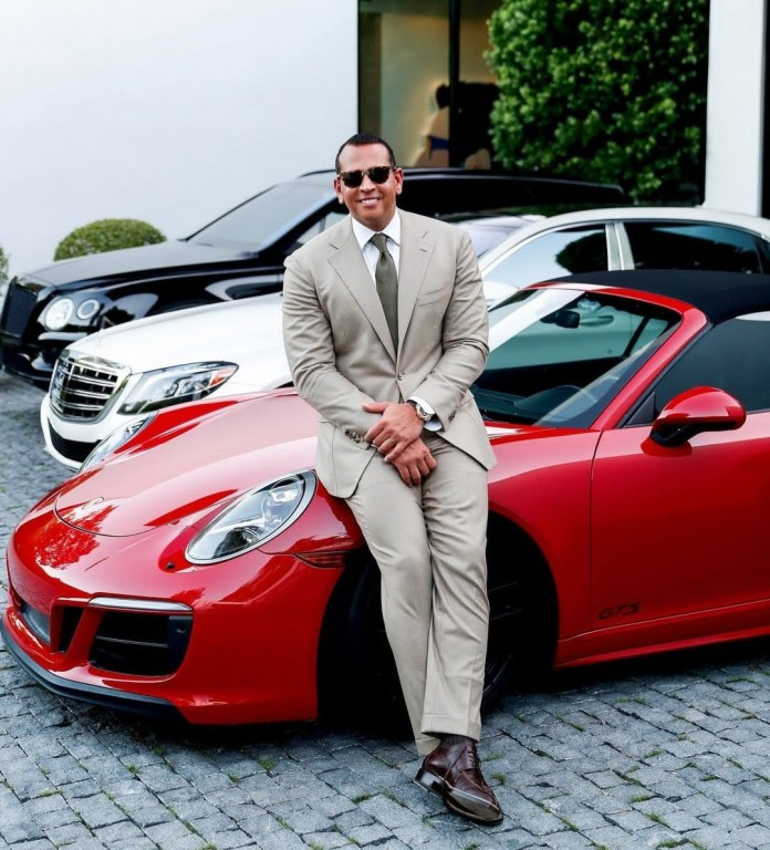 Savage Alex Rodriguez poses with the Porsche he gifted J.Lo for her 50th birthday