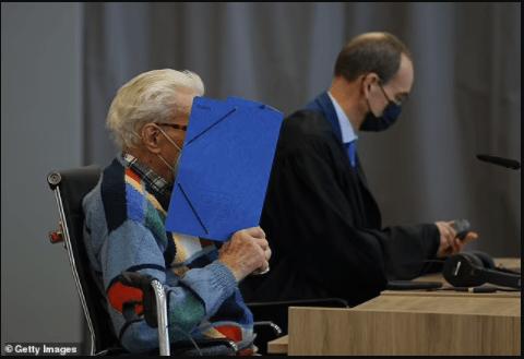 Death camp guard, 100, becomes the oldest person ever tried for Nazi-era crimes as he arrives at court in Germany