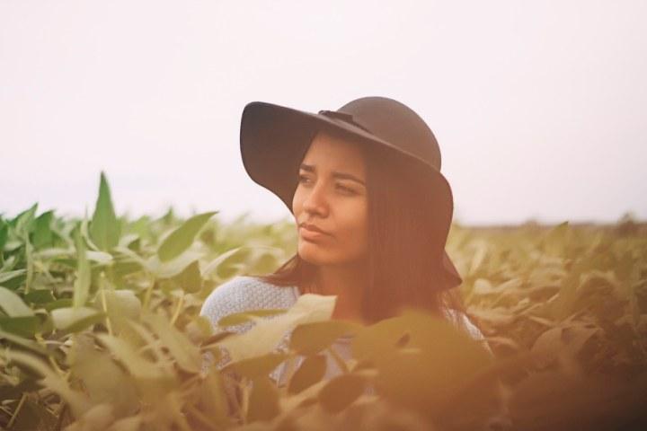 hats black woman grass outdoors