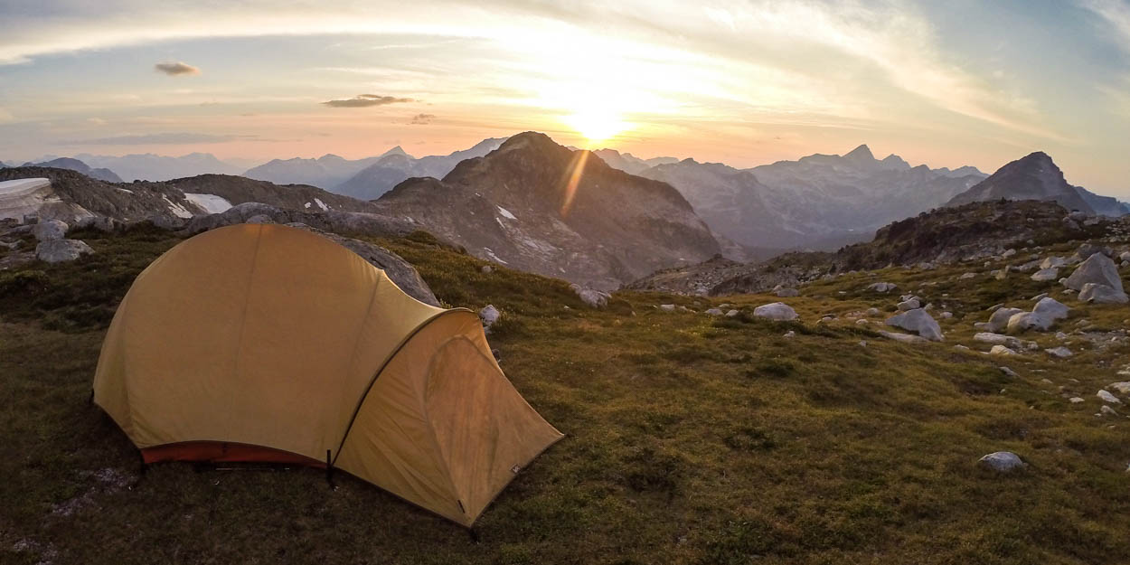 A tent sits on top of Mount Rohr as the sun sets