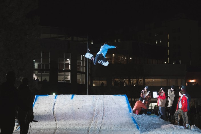 A snowboarder hits a jump at Thompson Rivers University