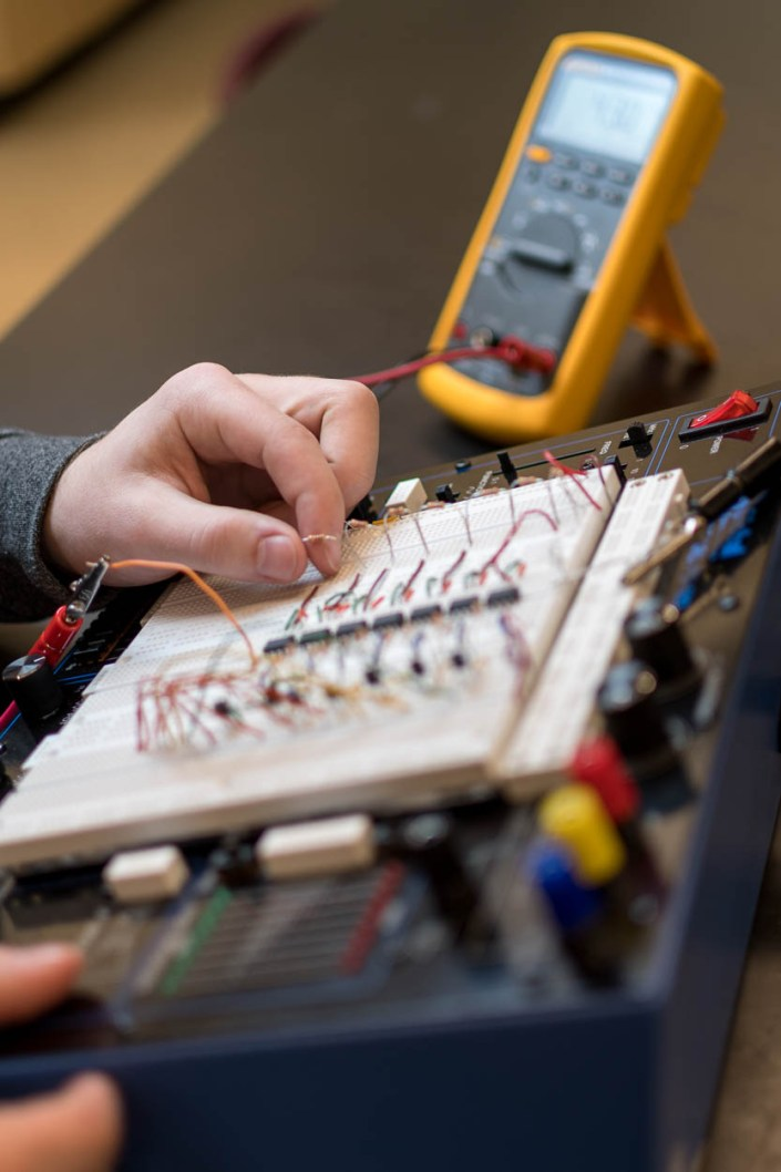 An engineering student at Thompson Rivers University completes a circuit exercise.