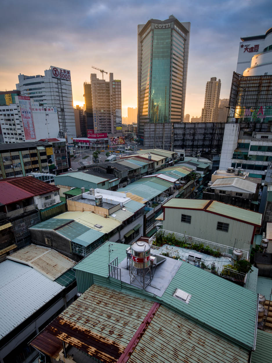 High-rise buildings of downtown Kaohsiung are lit by the rising sun.