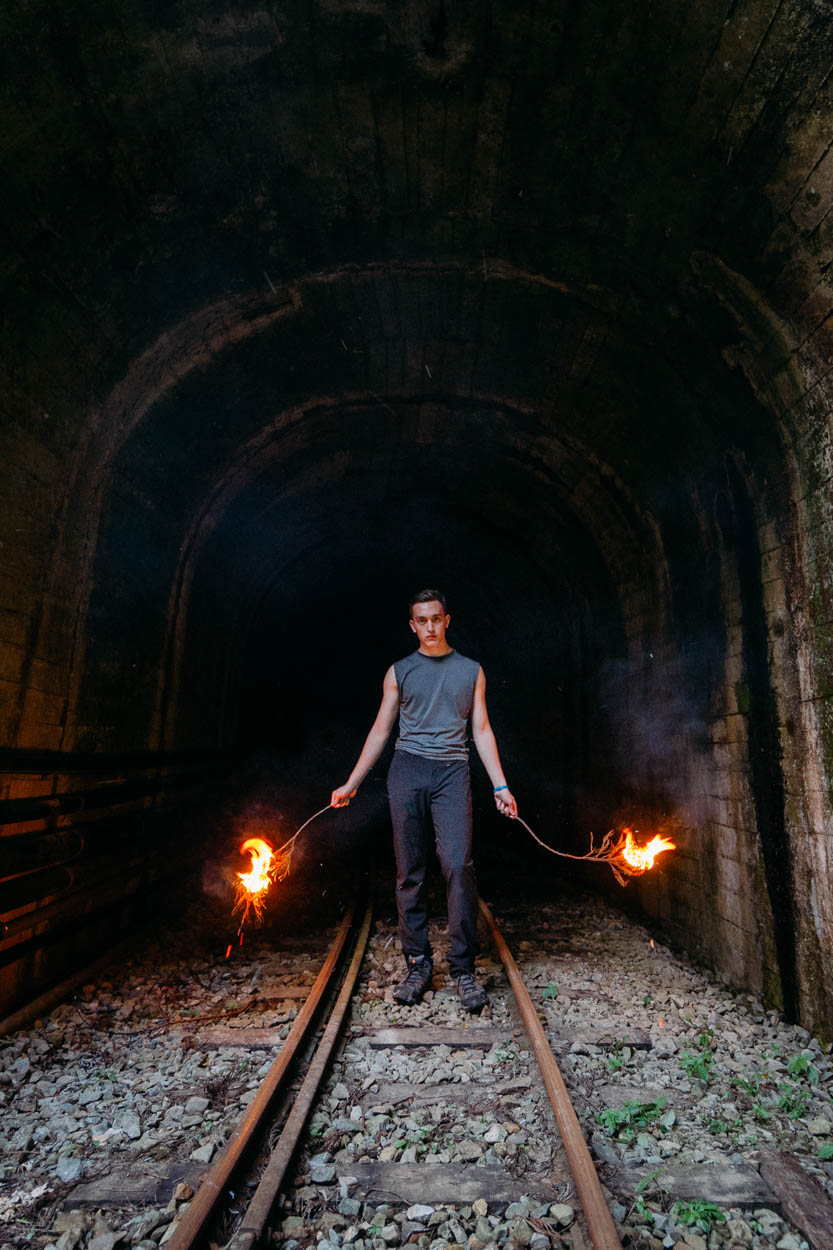 A young man explores the abandoned train tunnels of Alishan