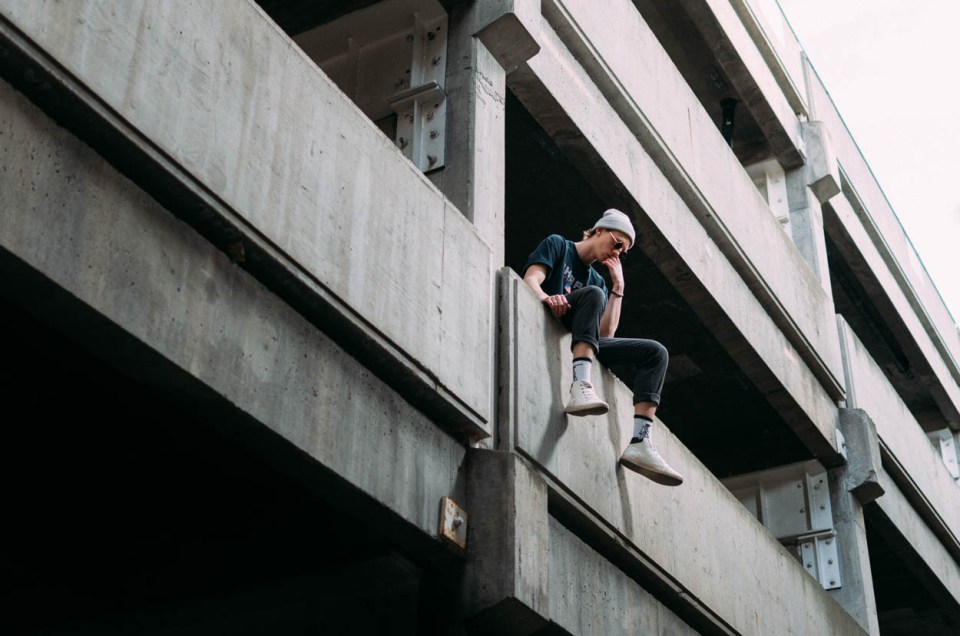 Model sits on the edge of parkade in Kamloops