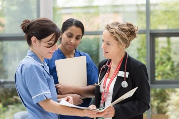 Hospital nursing staff in discussion