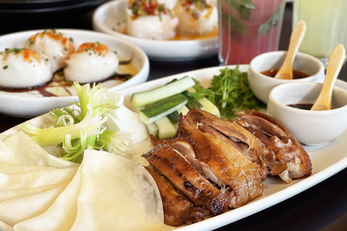 A platter of Chinese roast duck served with mandarin pancakes, vegetables and condiments from Emily Taylor Restaurant & Bar