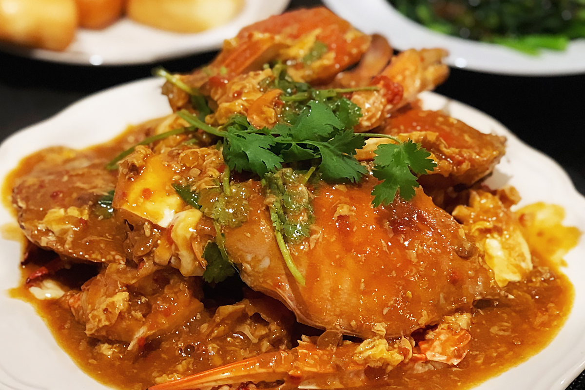 A plate of Singapore Chilli Crab garnished with fresh coriander