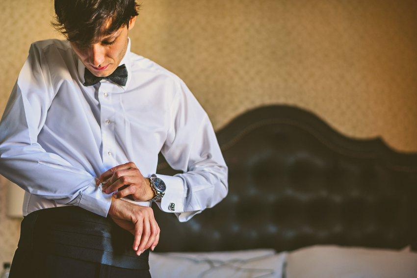 groom buttoning sleeves
