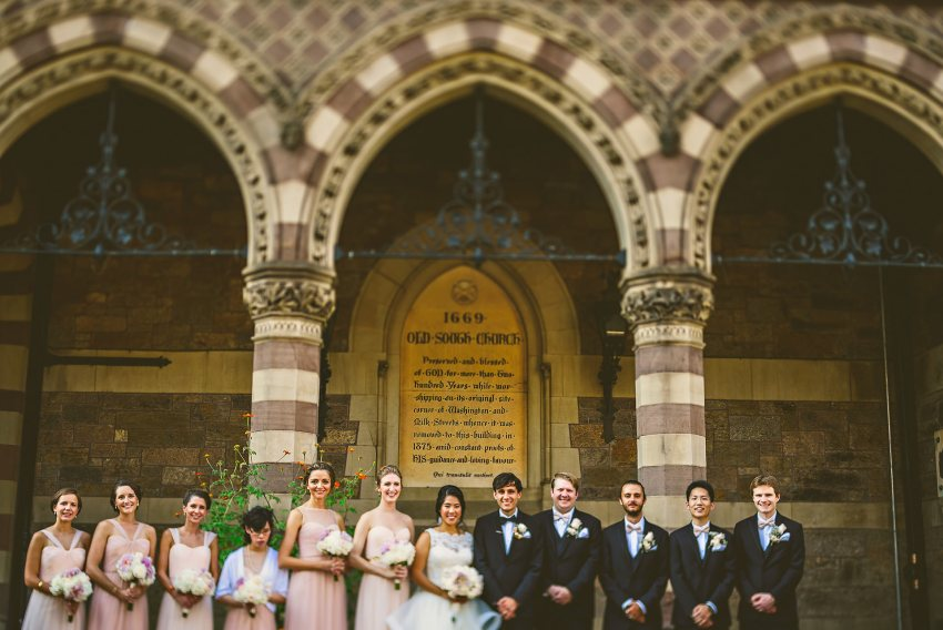 full wedding party portrait in front of church
