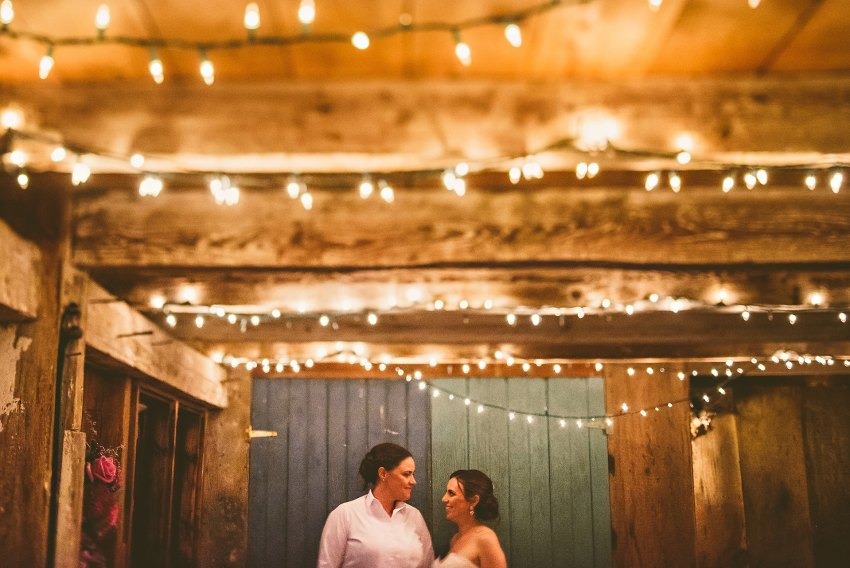 intimate same sex barn wedding photo