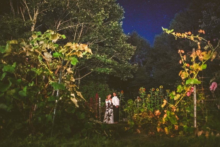 Nighttime wedding portrait on farm