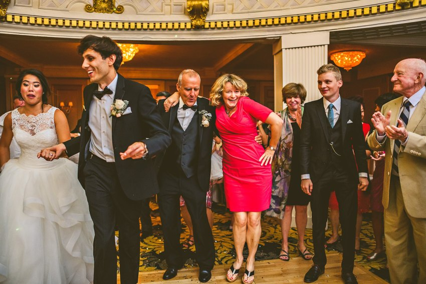 bride and groom and family dancing at reception