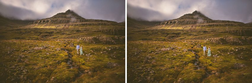 couple walking along Icelandic landscape terrain