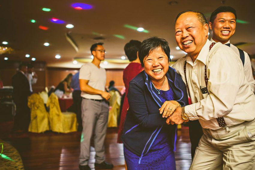 Dancing wedding guests at Hei La Moon