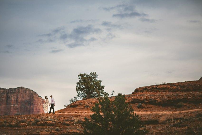 Wedding couple walking in Sedona