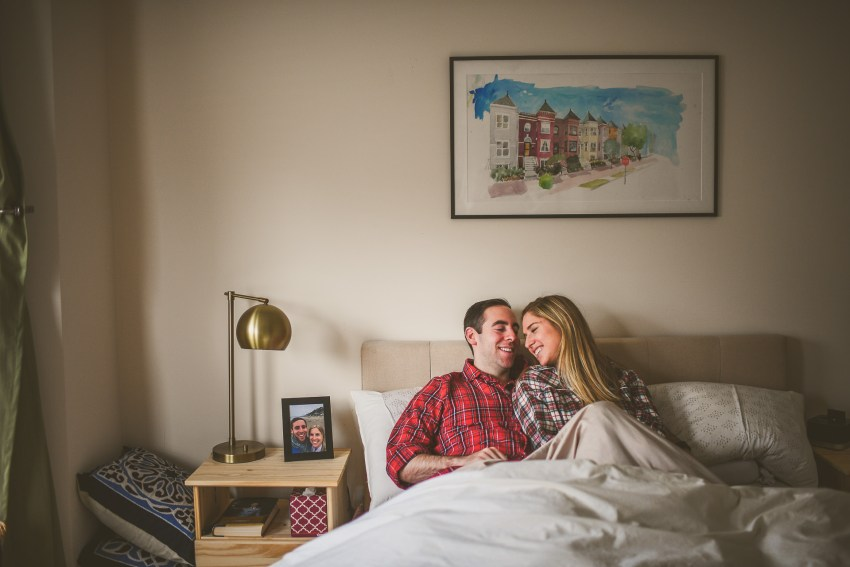 Engagement photos in bed with flannel