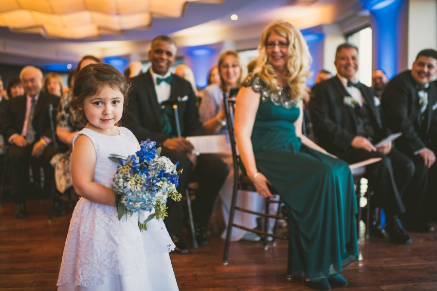 Flower girl walking up aisle