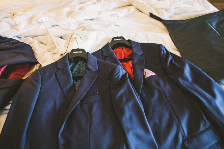 Groomsmen suits on bed