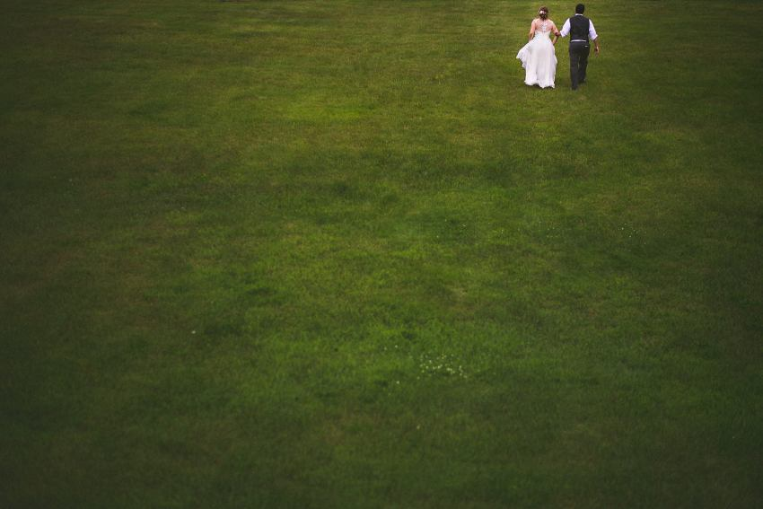 Bride and groom in grassy field