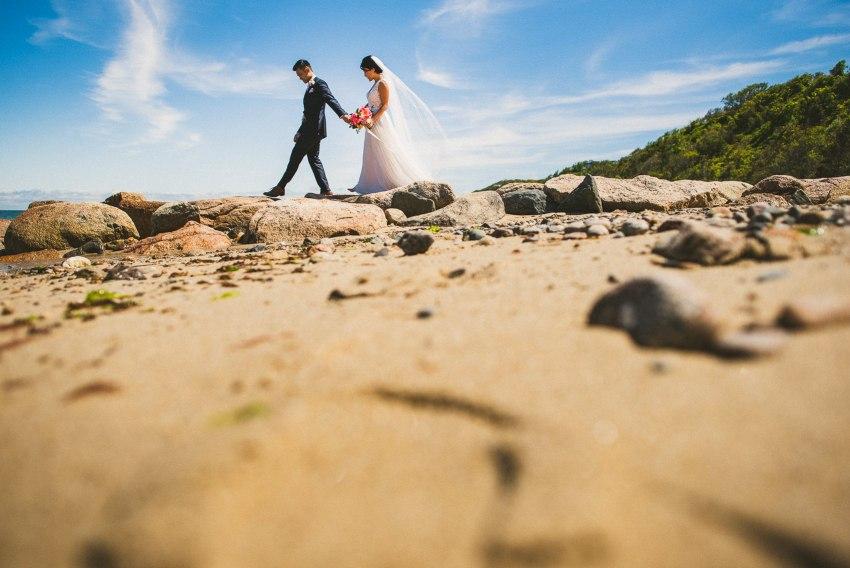 Bride and groom walking on rocks