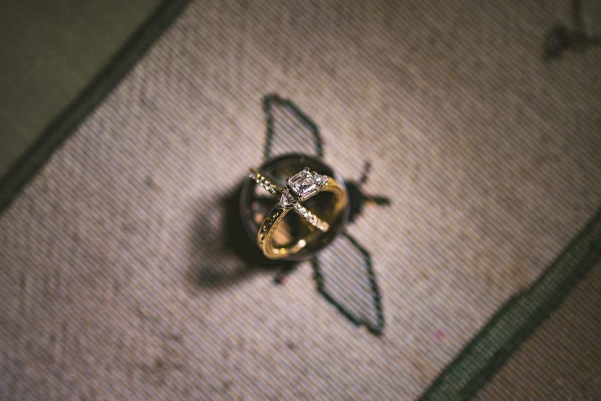 Wedding rings on bee tablecloth