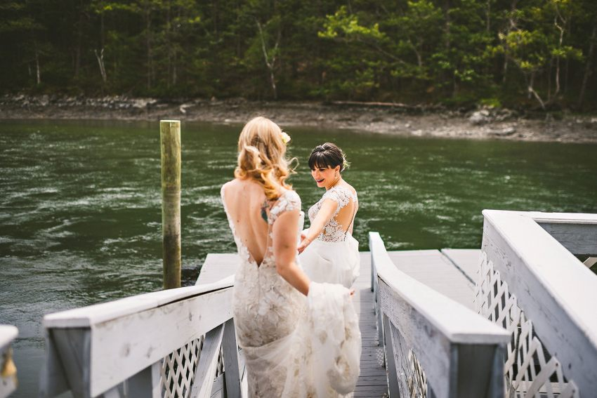 Brides walking on dock