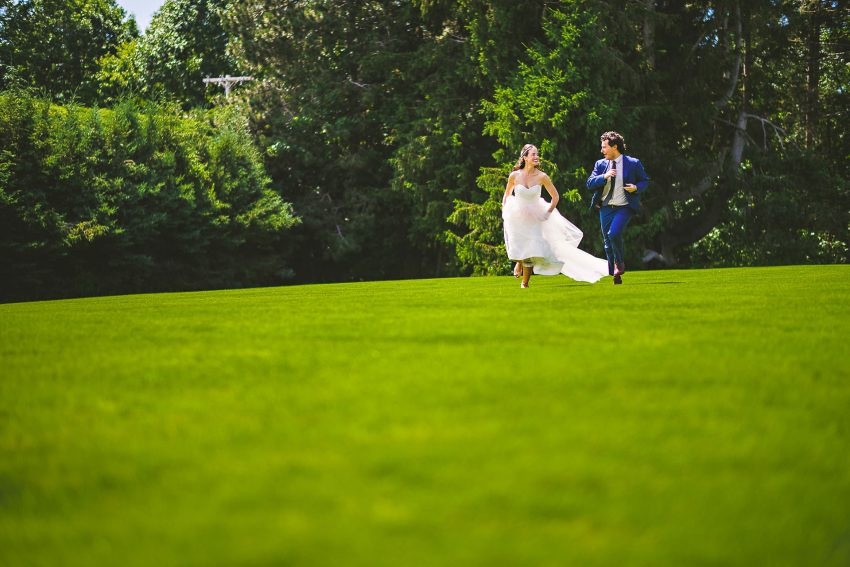 Bride and groom running at Tanglewood