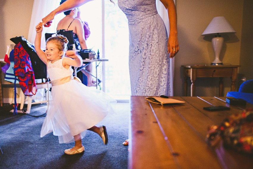 flower girl dancing before wedding