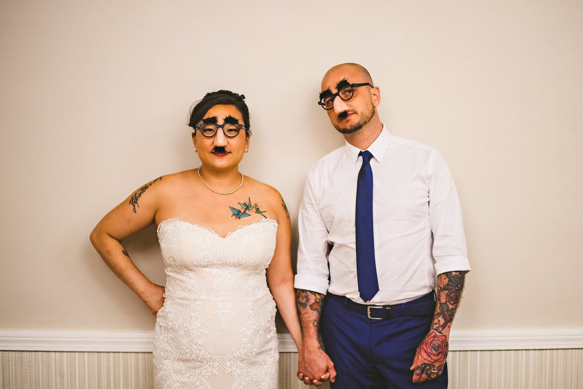 Bride and groom with fake glasses