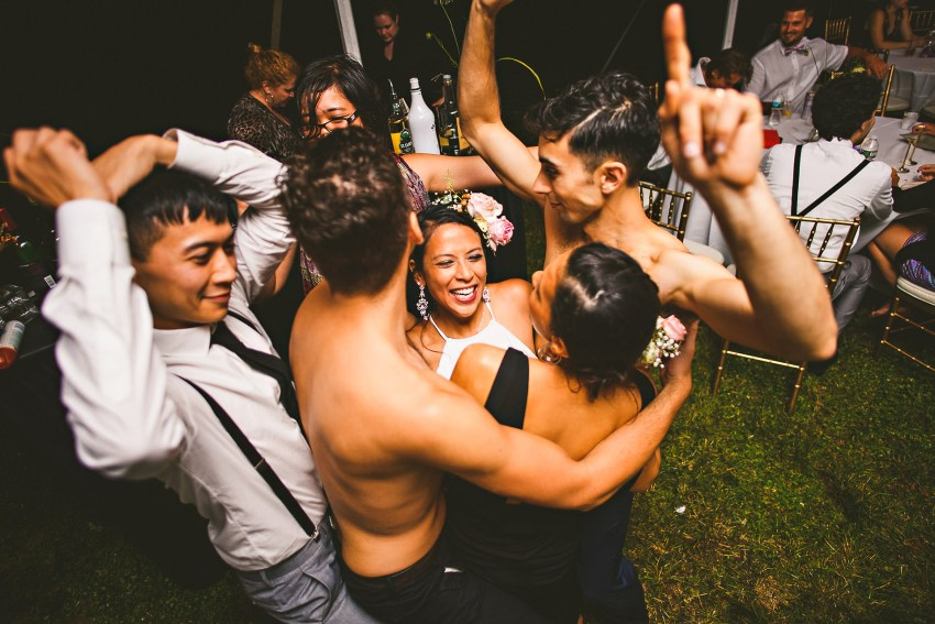 Wedding party dancing after swimming