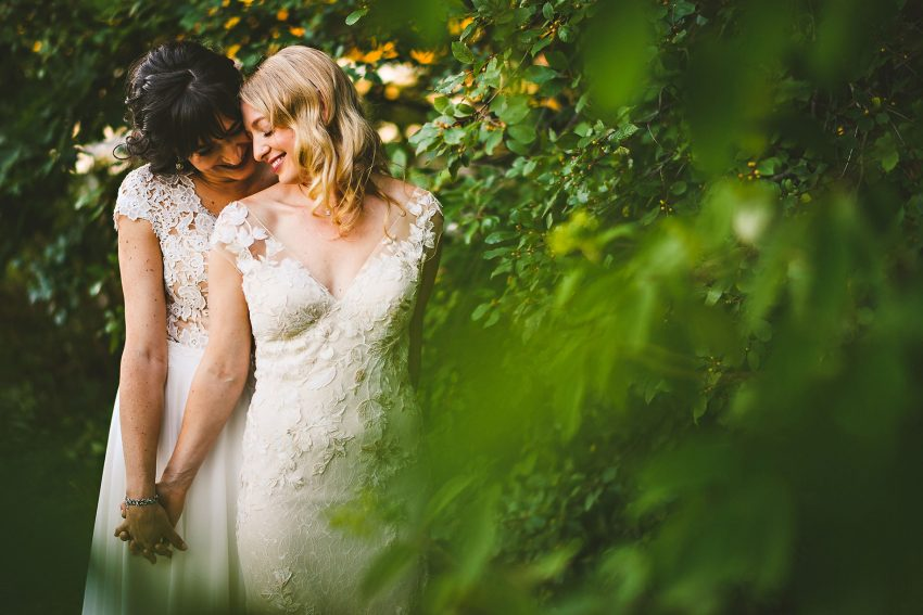 Intimate same sex wedding portrait in Maine
