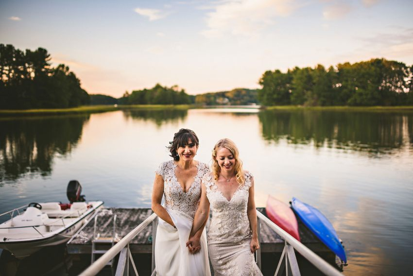 Brides walking along dock