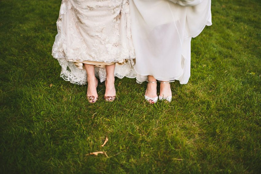 Brides showing shoes under dresses