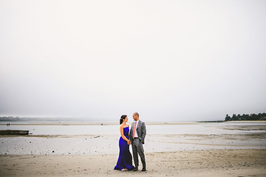 Bride and groom on Maine beach