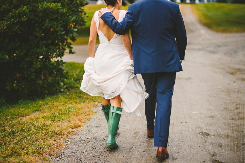 Bride and groom walking along muddy path