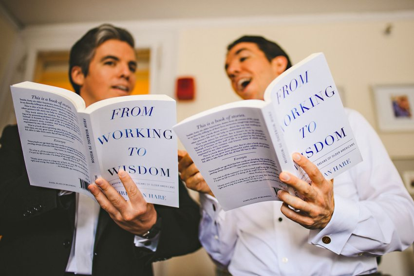 Groom and brother reading books